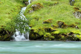 Waterfall to blue river in Norway — Stock Photo