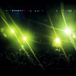 Stage with green light flares and audiences. — Stock Photo #35773061