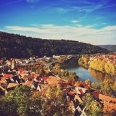 Beautiful German town Wertheim at a sunny autumn day with blue sky and river. — Stock Photo