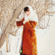 Girl in a Russian village in the winter. — Stock Photo