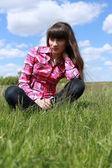 Girl walks on the flowered field. — Stock Photo