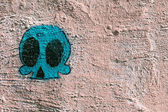 Graffiti abstract background with the drawn skull — Foto de Stock