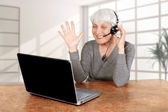 Elderly woman at the computer communicates, mother, grandmother  — Stock Photo