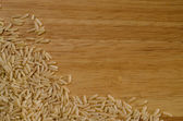 Brown rice on wood — Stock Photo