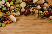 Legumes on wood, close-up, background — Stock Photo