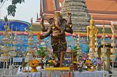 Ganesha statue and offerings — Stock Photo