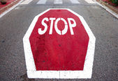 Stop signal on asphalt — Stock Photo