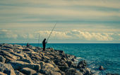 Fishing in the beackwave — Stock Photo