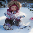A child plays in the snow — Stock Photo