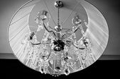 A crystal chandelier with a white shade — Photo