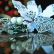 Figure of heart and white flower reflected on the glass — Stock Photo