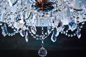 A crystal chandelier with a white shade — Stock Photo