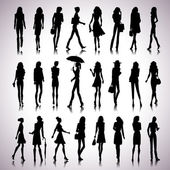 Urban women silhouettes — Stock Vector