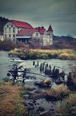An old house near by river — Stock Photo