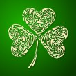 St. Patrick's day background with clover in green colors. — Stock Vector