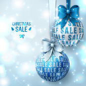 Christmas sale - Blue Christmas baubles on light background. — Stock Vector