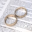 Couple of gold wedding rings on a dictionary page showing love definition — Stock Photo #36926889