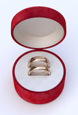 Couple of gold wedding rings in jewelry red box — Stock Photo