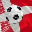 Denmark waving flag and soccer ball in goal net — Stock Photo
