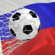 Russia waving flag and soccer ball in goal net — Stock Photo