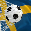 Stock Photo: Sweden waving flag and soccer ball in goal net