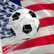 USA waving flag and soccer ball in goal net — Stock Photo