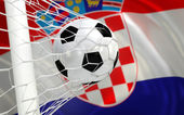 Croatia waving flag and soccer ball in goal net — Stock Photo