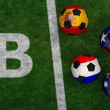 Soccer balls with flags of Spain, Australia, Netherlands, Chile — Stock Photo