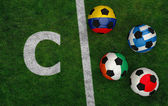 Soccer balls with flags of Greece, Japan, Ivory Coast, Colombia — Stock Photo