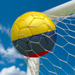 Colombia flag and soccer ball in goal net — Stockfoto #39980893