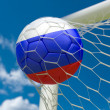 Russia flag and soccer ball in goal net — Stock Photo