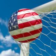 USA flag and soccer ball in goal net — Stock Photo