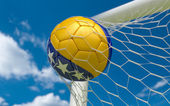 Bosnia flag and soccer ball in goal net — Stock Photo