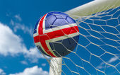 Iceland flag and soccer ball in goal net — Stock Photo