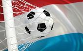 Флаг Люксембурга и футбольный мяч в ворота — Стоковое фото