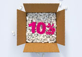 Box with shipping peanuts and 10 percent off sign — Stock Photo