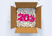 Box with shipping peanuts and 20 percent off sign — Stock Photo