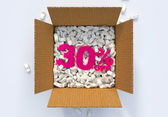 Box with shipping peanuts and 30 percent off sign — Stock Photo