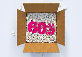 Box with shipping peanuts and 60 percent off sign — Stock Photo
