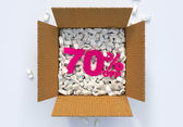 Box with shipping peanuts and 70 percent off sign — Stock Photo