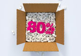 Box with shipping peanuts and 80 percent off sign — Stock Photo