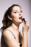 Young Woman Putting on Lipstick — Stock Photo
