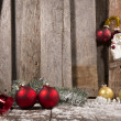 Christmas Ornaments on a Wooden Background — Stock Photo #35870889