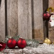 Stock Photo: Christmas Ornaments on a Wooden Background