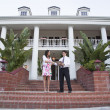Man and Woman in Front of a Large House — Stock Photo