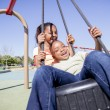 Two Young Girls Having Fun in a Playground — Stock Photo #35873947