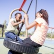 Stock Photo: Two Young Girls Having Fun in a Playground