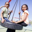 Two Young Girls Having Fun in a Playground — Stock Photo #35873959
