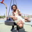 Two Young Girls Having Fun in a Playground — Stock Photo #35873961