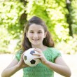 Young Girl Holding a Soccer Ball — Stock Photo